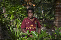 Jenny Songan stands in a mangrove forest in Papua New Guinea