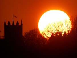 The sun balances next to St Albans Church in Earsdon, North Tyneside.