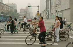 Tianjin: commuters resting at a traffic light [Credit: Saurabh Das/AP]